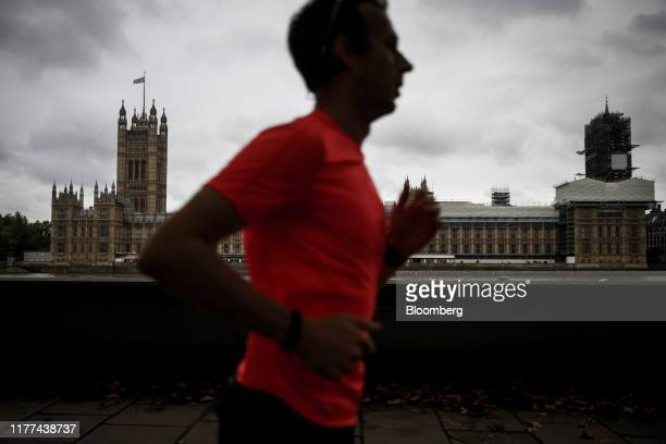 A jogger passes the Houses of Parliament in London UK on Monday Oct 21 2019 UK Prime Minister Boris Johnson is making a fresh bid to deliver on his...
