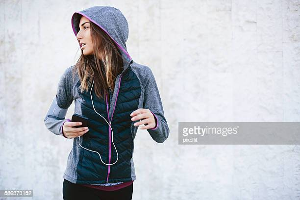 jogger - hood clothing stock photos and pictures