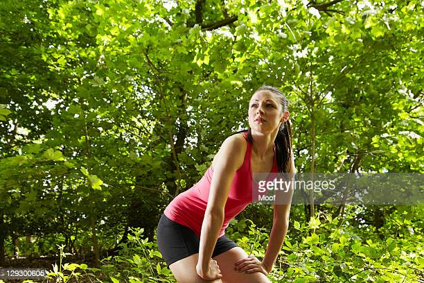 Jogger resting in forest