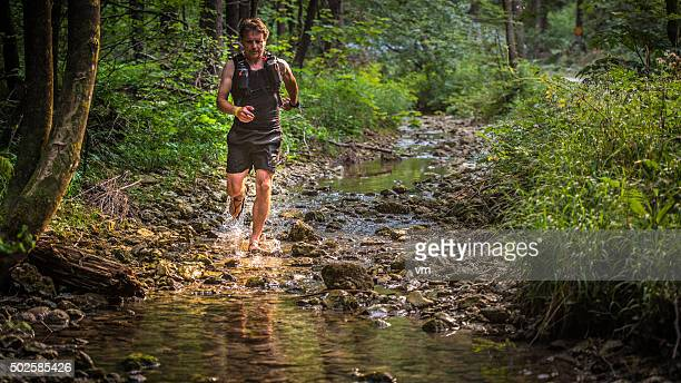 Jogger running downstream in a forest
