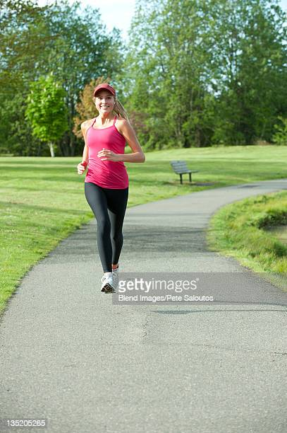 jogger running in park - bainbridge island stock pictures, royalty-free photos & images