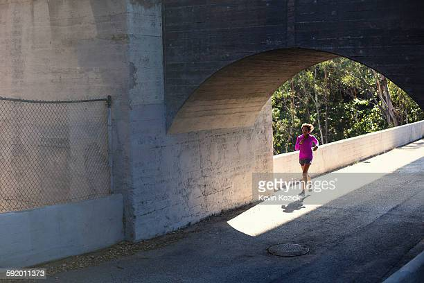 Jogger running on bridge, Arroyo Seco Park, Pasadena, California, USA