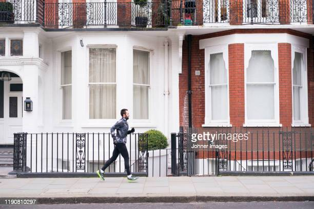 jogger running - urban road stock pictures, royalty-free photos & images