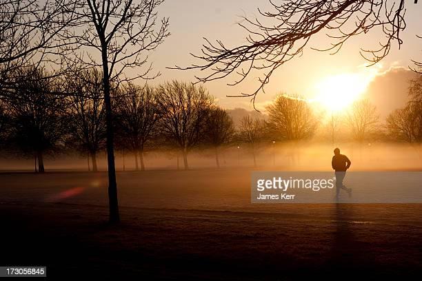 A jogger running through the mist