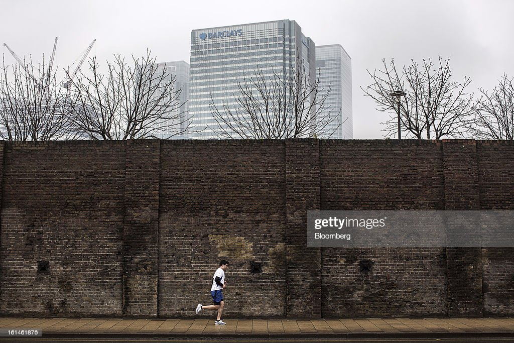 A jogger runs near the headquarters of Barclays Plc in the Canary Wharf business and financial district in London, U.K., on Monday, Feb. 11, 2013. Barclays Plc Chief Executive Officer Antony Jenkins's pledges to shred the legacy of his predecessor and fix the lender's culture are distracting from the difficulty he has in reviving profit at Britain's biggest investment bank. Photographer: Jason Alden/Bloomberg via Getty Images