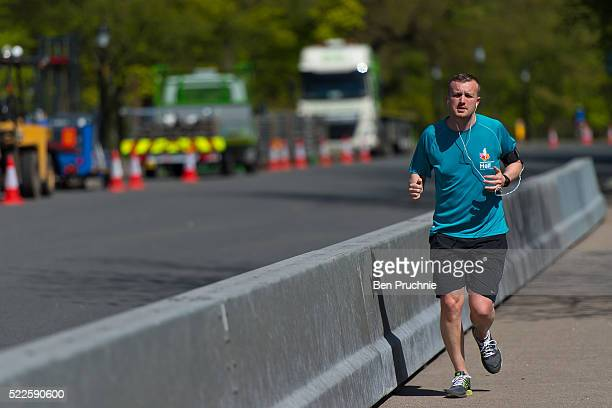 A jogger runs past security barriers outside Winfield House in Regents Park ahead of US President Barack Obama's visit to the UK on April 20 2016 in...