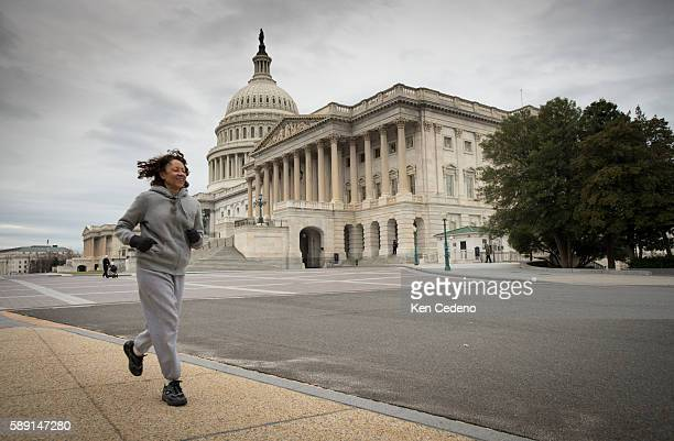 A jogger runs past the US Capitol at the beginning of a new year Jan 1 2013 following the 'fiscal cliff' deal made Dec 31 2012 on Capitol Hill in...