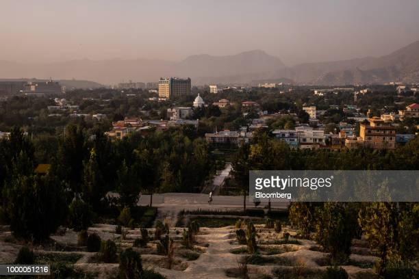A jogger runs through the Bibi Mahru Hill area of Kabul Afghanistan on Sunday July 15 2018 US President Donald last year said 16000 US troops would...