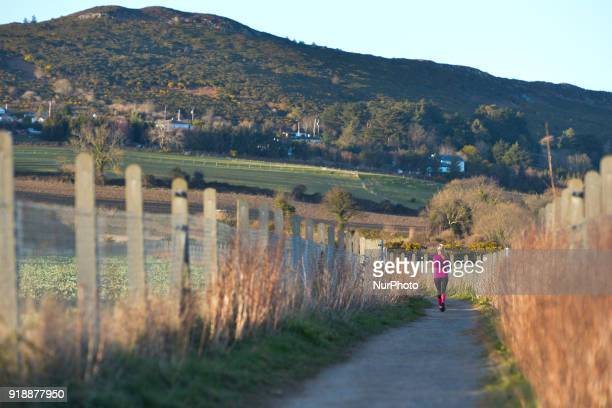 A jogger seen on the path of BrayGreystones cliff walk On Thursday February 15 Dublin Ireland