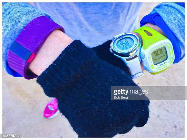 Santa Monica Ca December 13 2015 A jogger shows her wearable sports tech as she jogs on a cold morning