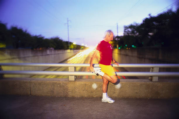 Jogger stretching on overpass