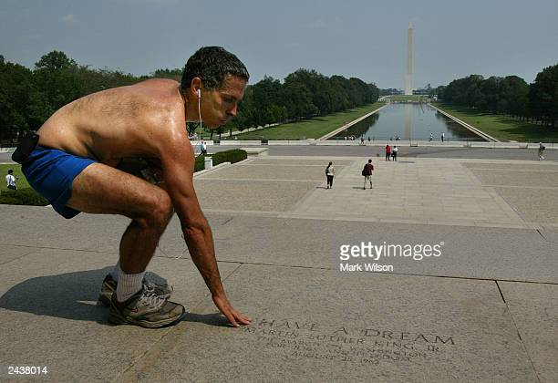 A jogger who wished not to be identified touches a stone inscription on the steps of the Lincoln Memorial that marks the spot where Dr Martin Luther...