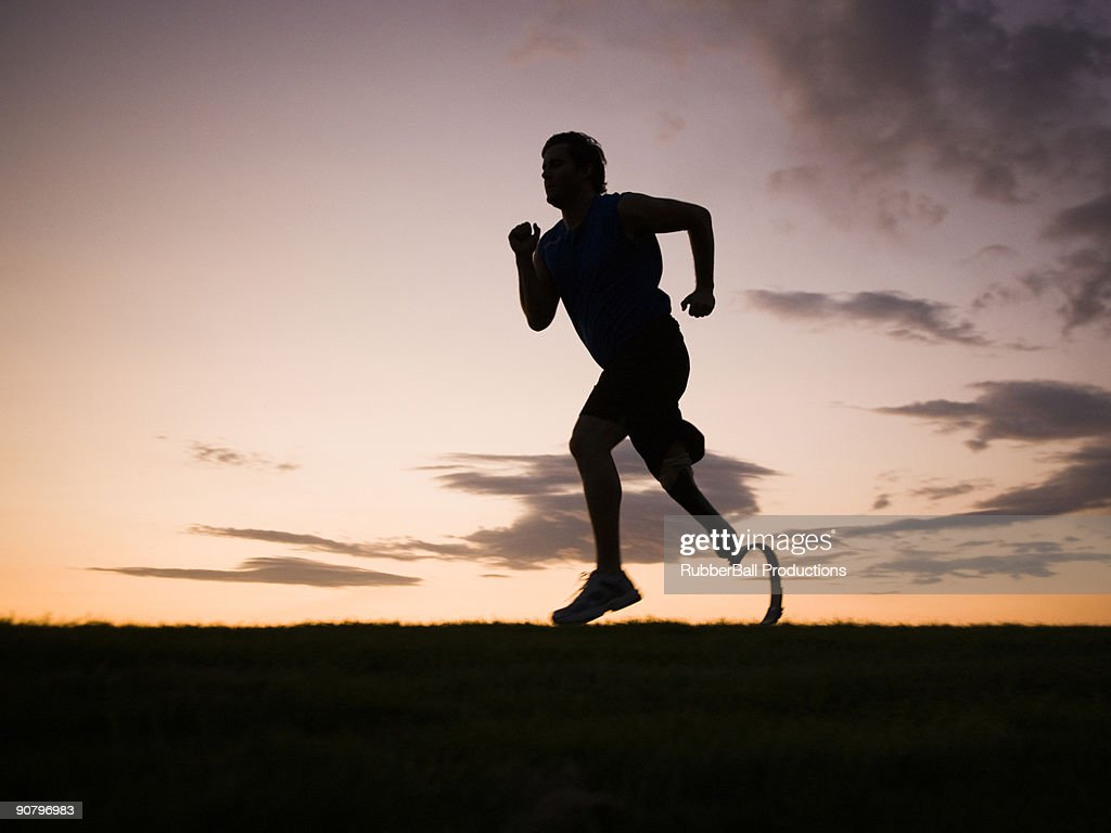 jogger with a right below knee prosthetic running leg : Stock Photo