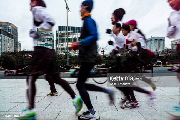joggers around imperial palace - imperial palace tokyo stock photos and pictures