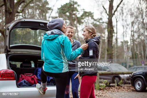Joggers communicating by car in forest