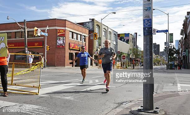 Joggers on Bloor Street, Toronto, Ontario, Canada in Summer