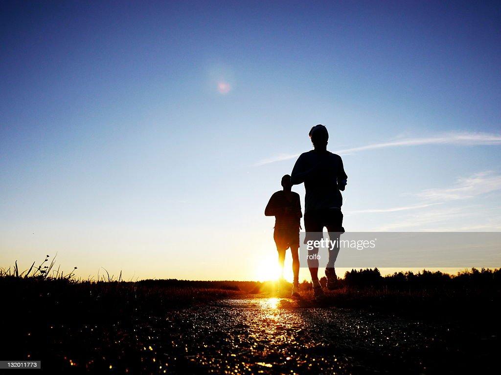 Joggers running along path : Stock Photo