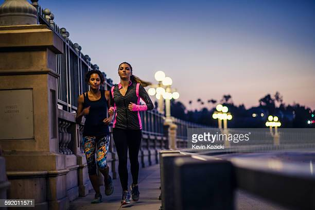 joggers running on bridge, arroyo seco park, pasadena, california, usa - black women wearing pantyhose stock pictures, royalty-free photos & images