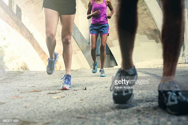 Joggers running on bridge