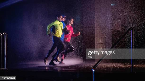 Joggers running on rainy night