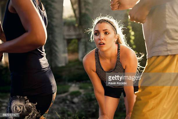 joggers running past jogger taking break, arroyo seco park, pasadena, california, usa - struggle stock pictures, royalty-free photos & images