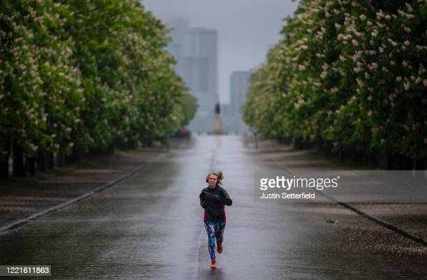 Joggers take their daily exercise in the rain at Greenwich Park on April 28 2020 in London England British Prime Minister Boris Johnson who returned...