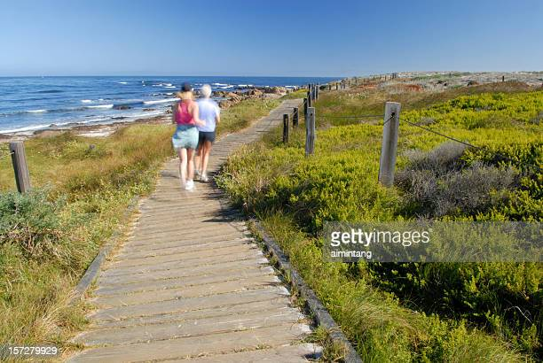 jogging at spanish bay - pebble beach california stock pictures, royalty-free photos & images
