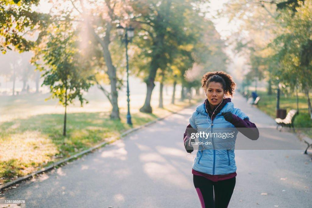 Jogging in autumn park : Stock Photo