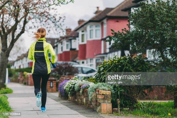 jogging in london - high street stock pictures, royalty-free photos & images