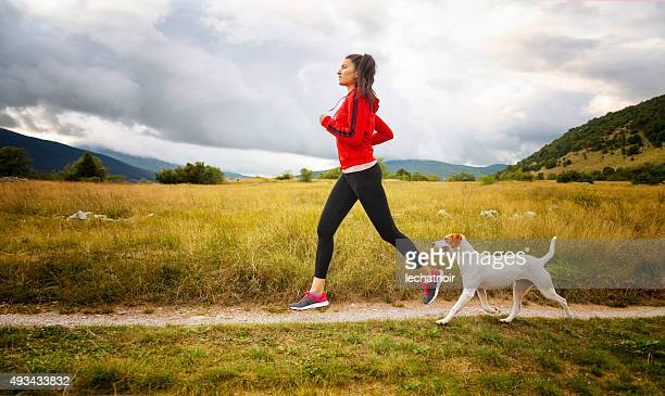 jogging in the beautiful nature - red shirt stock pictures, royalty-free photos & images
