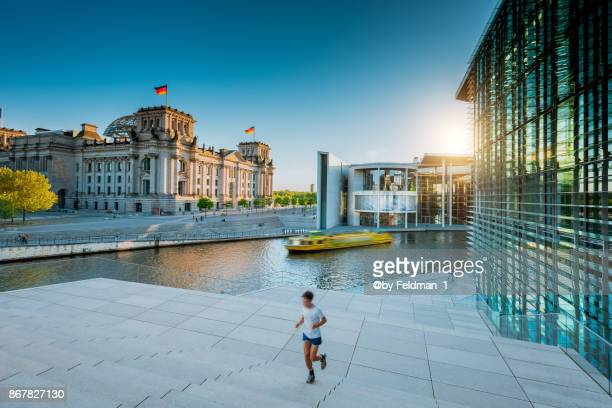 jogging in the berlin government district, berlin,germany - central berlin stock photos and pictures
