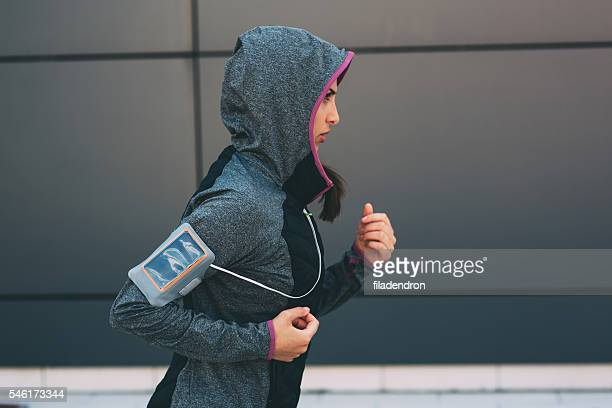jogging in the city - hoodie headphones stock pictures, royalty-free photos & images