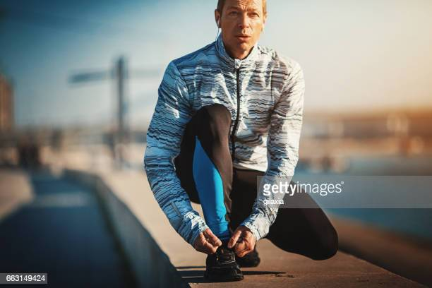 jogging in the morning. - forward athlete stock pictures, royalty-free photos & images