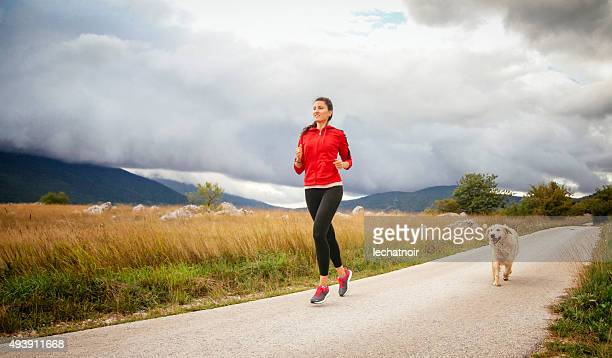 Jogging in the nature with pet dog