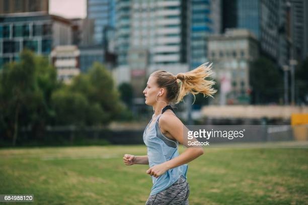 jogging in the park - melbourne australia stock pictures, royalty-free photos & images