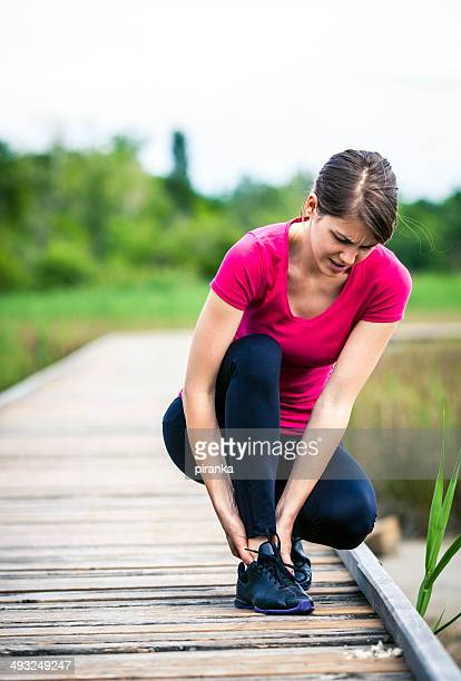 jogging injury - swollen ankles stock pictures, royalty-free photos & images