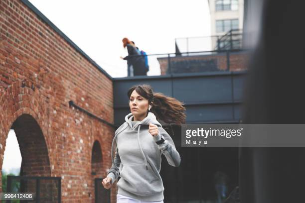 jogging makes me feel powerful - hoodie headphones stock pictures, royalty-free photos & images