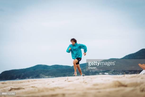 Jogging near the sea shore - preparation for marathon