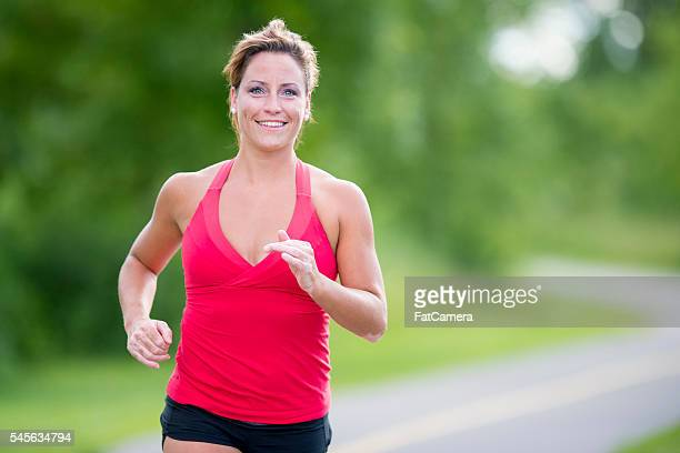 jogging on a sunny day - 5000 meter stock pictures, royalty-free photos & images