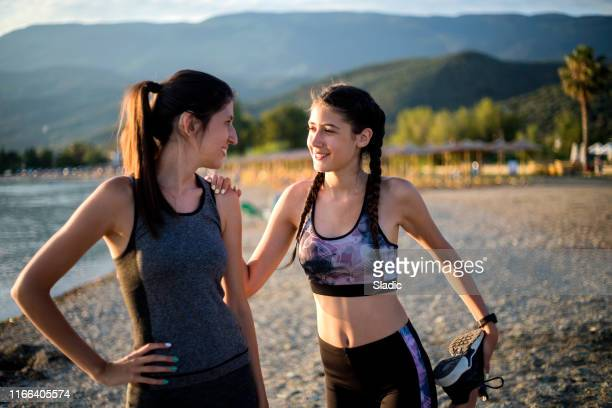 jogging on the beach - sports training camp stock pictures, royalty-free photos & images
