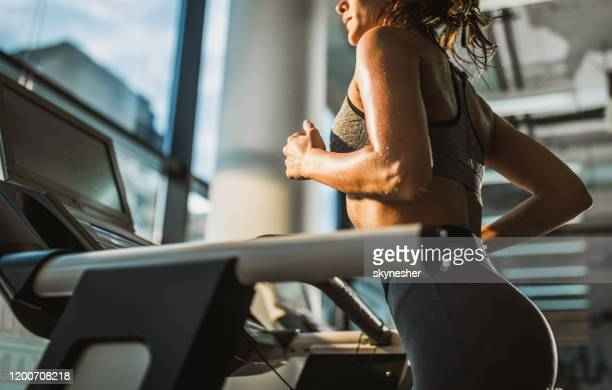 jogging on treadmill in a gym! - warm up exercise stock pictures, royalty-free photos & images