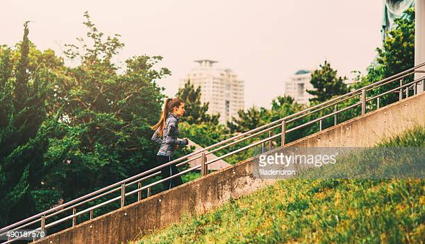 jogging outside in the city - center athlete stock pictures, royalty-free photos & images