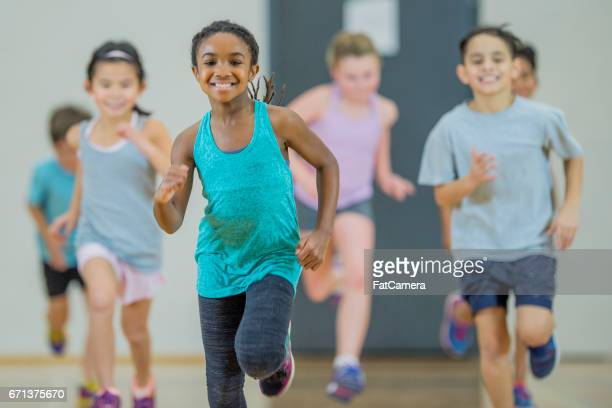 jogging - physical education stock pictures, royalty-free photos & images