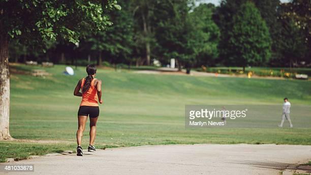 jogging through the city park - piedmont park atlanta georgia stock pictures, royalty-free photos & images