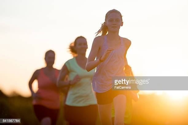 jogging together at dusk - 5000 meter stock pictures, royalty-free photos & images