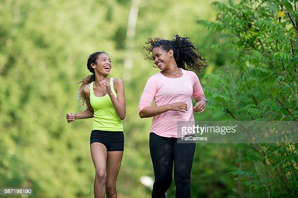 jogging together through the woods - black mothers day stock pictures, royalty-free photos & images