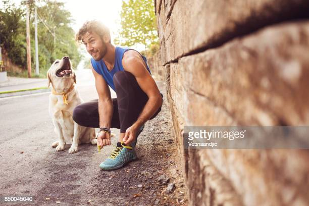 jogging with my best friend - dog stock pictures, royalty-free photos & images