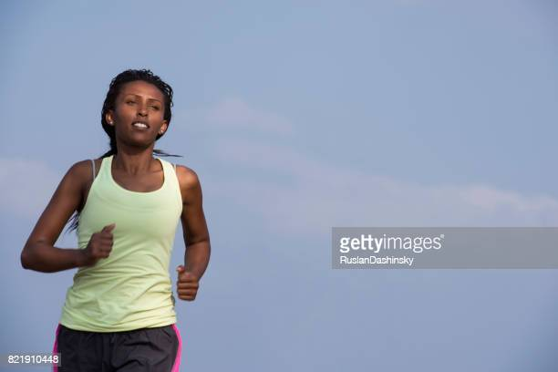 Jogging woman running outdoors. Female runner during outdoor workout.
