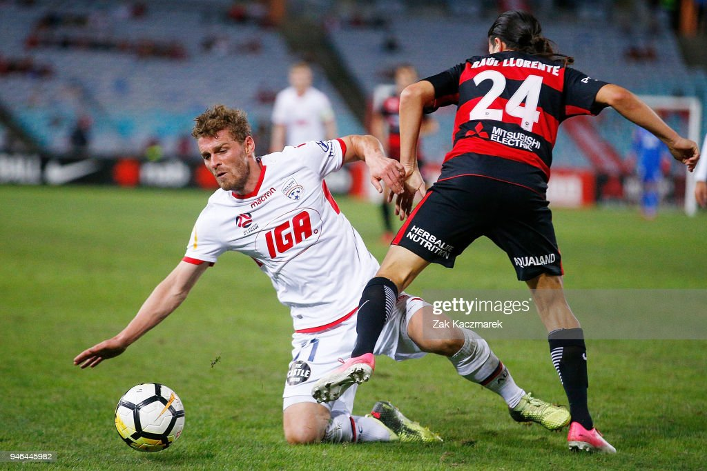 Johan Absalonsen of Adelaide challenges Raul Llorente of the Wanderers during the round 27 A-League match between the Western Sydney Wanderers and Adelaide United at ANZ Stadium on April 15, 2018 in Sydney, Australia.