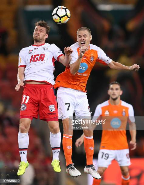 Johan Absalonsen of Adelaide United and Thomas Kristensen of the Brisbane Roar compete for the ball during the round 22 ALeague match between the...